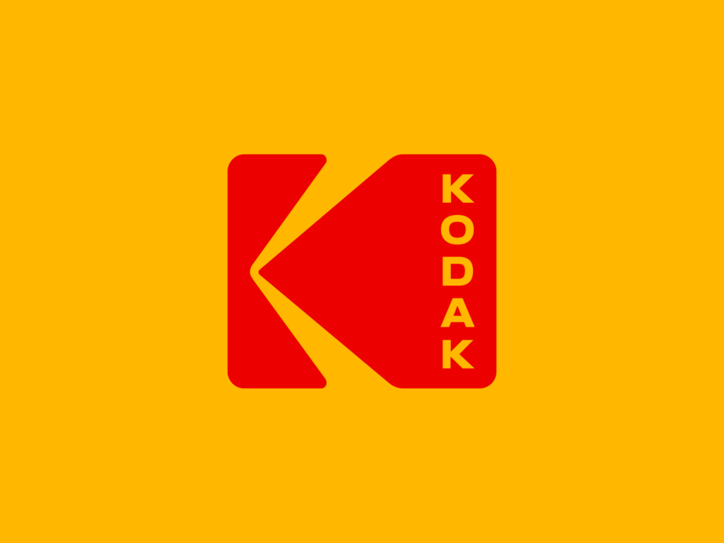 Kodak logo with its iconic red-and-yellow camera-shutter by Graphic artist C. Peter Oestrich